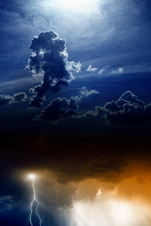 dark clouds: Dramatic background - lightning and rain in sunset sky, dark clouds, light from above Stock Photo
