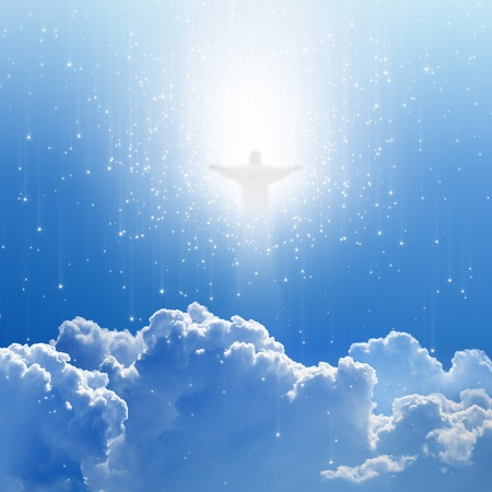 Jesus Christ in blue sky with white clouds and stars - heaven, easter Фото со стока
