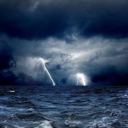 wind storm: Dramatic nature background - lightnings in dark sky, stormy sea Stock Photo