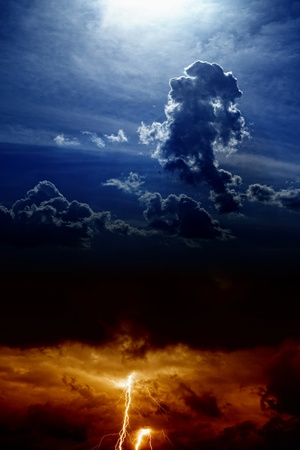 Dramatic background - lightning and rain in sunset sky, dark clouds, light from above Stock Photo - 17842454