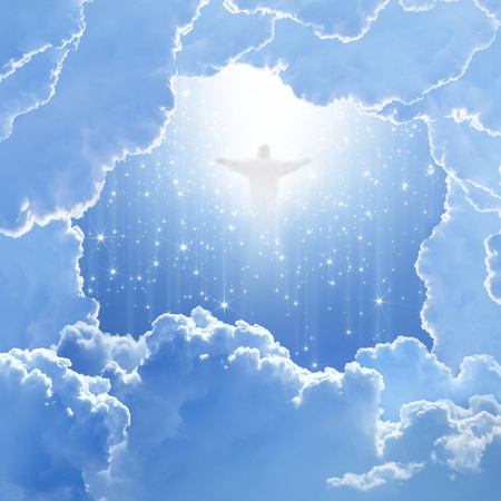 Jesus Christ in blue sky with white clouds and falling stars - heaven, easter Фото со стока