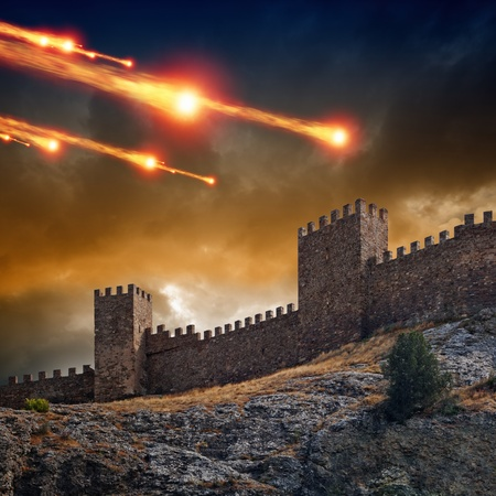 castle rock: Dramatic background - old fortress, tower under attack  Dark stormy sky, asteroid, meteorite impact Stock Photo