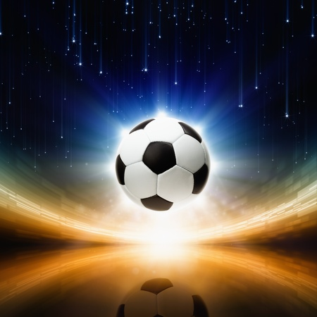 Sports background - soccer ball, bright light, abstract stadium, arena