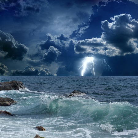 thunderstorm: Dramatic nature background - lightnings in dark sky, stormy sea Stock Photo
