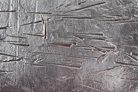 solidity: Abstract background - dark scratched textured metal, steel