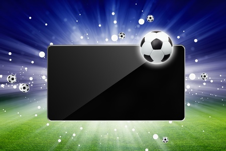 Sports background - soccer ball, tablet computer, bright light, green stadium, soccer live photo