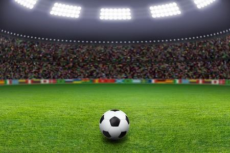 stadium soccer: Soccer ball on green stadium, arena in night illuminated bright spotlights