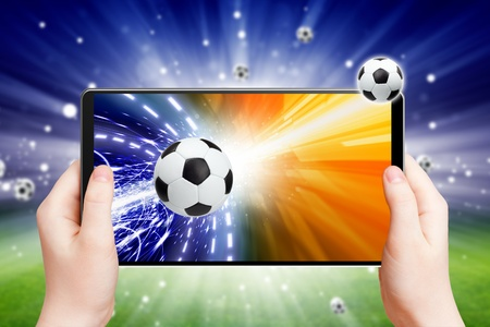 Abstract tablet pc in hands, soccer ball on screen, multimedia gadget, soccer, football online
