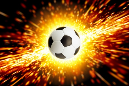 Abstract sports background - soccer ball, big explosion, fire photo