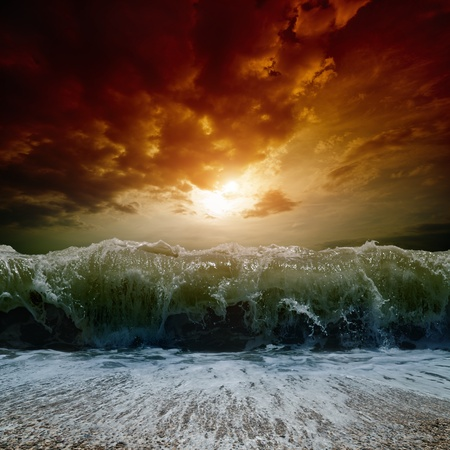 Dramatic nature background - big wave, stormy sea, red sunset Stock Photo