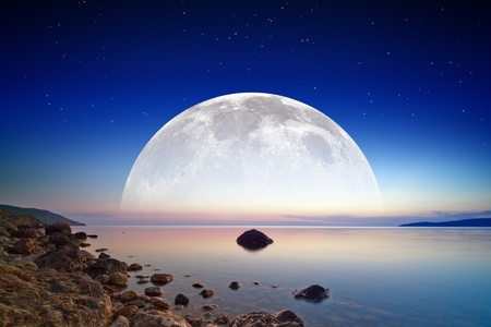 Abstract fantastic background - dark blue sky, smooth serene sea, full moon and stars in space  Stock Photo - 20334538