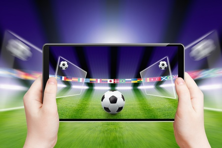 reality: Abstract technology background - tablet pc, computer in hands, soccer ball, sports game online, soccer online, augmented reality Stock Photo