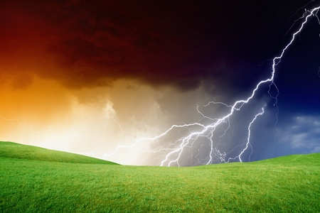 Abstract nature background - green hills, dark stormy sky, lightning photo