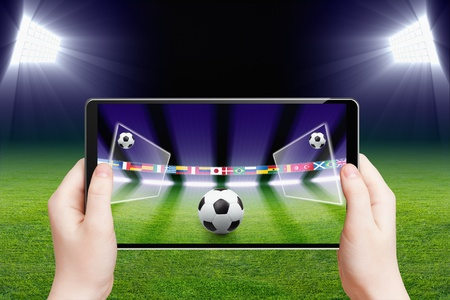 Abstract technology background - tablet pc, computer in hands, soccer ball, sports game online, soccer online, augmented reality Foto de archivo