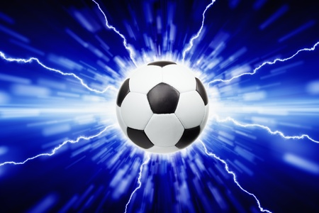 Abstract sports background - soccer ball, bright lights and lightnings photo