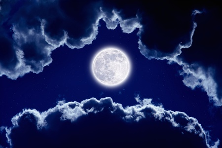 Full moon in dark night sky with stars and clouds. photo