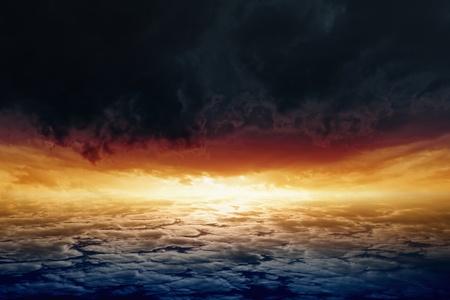 Dramatic background - red sunset, glowing horizon, dark clouds photo
