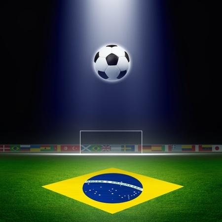 Soccer ball, green soccer stadium, arena in night illuminated bright spotlights, soccer goal, Brazil flag Foto de archivo