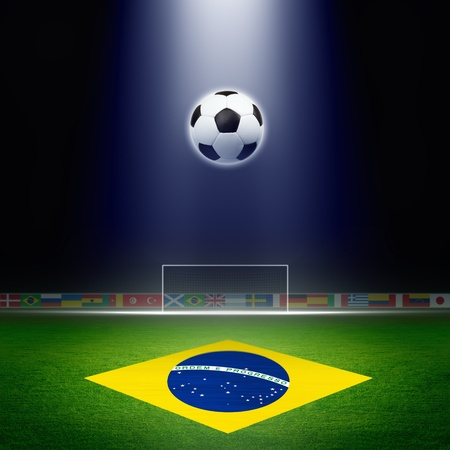 Soccer ball, green soccer stadium, arena in night illuminated bright spotlights, soccer goal, Brazil flag Reklamní fotografie