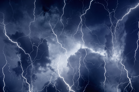 Nature force background - lightnings in dark stormy sky