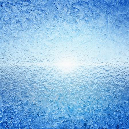 frozen glass: Abstract winter background - frozen water, ice on glass, bright sunlight