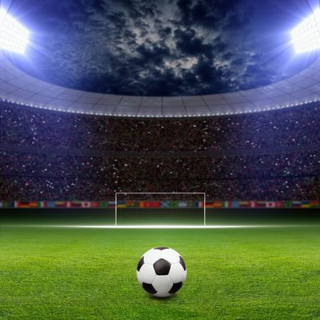 Soccer statium, soccer ball on green stadium, arena in night illuminated bright spotlights, soccer goal
