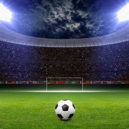 Soccer statium, soccer ball on green stadium, arena in night illuminated bright spotlights, soccer goal