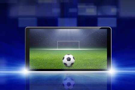 Technology, sports background - tablet pc, computer, soccer ball, sports game online, soccer online photo