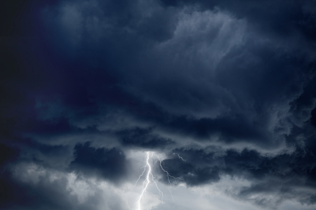 Nature force background - bright lightning in dark stormy sky  photo