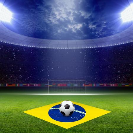 soccer goal: Soccer ball, green soccer stadium, arena in night illuminated bright spotlights, soccer goal, Brazil flag Stock Photo