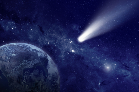 Scientific and astrological background - comet approaches planet earth, space with stars and nebula; mystical sign in sky. Elements of this image furnished by NASA