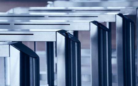 turnstile: Modern metallic turnstile gate, entrance of railway station or airport