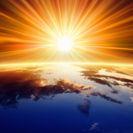 gods: Abstract religious backgrounf - bright sun shines above planet Earth