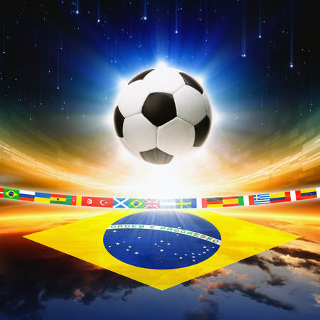 Abstract sports background - soccer ball, Brazil flag, bright light, stars in night sky