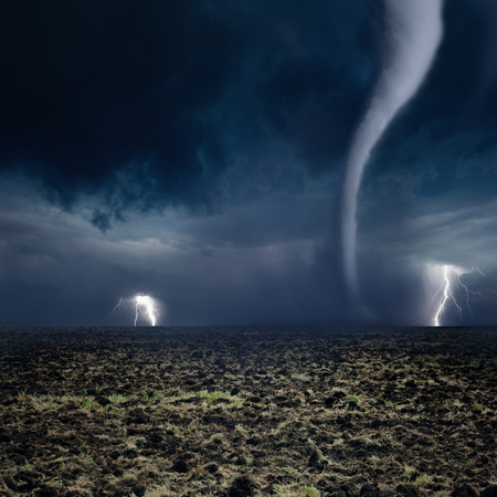 Nature force background - huge tornado, bright lightning in dark stormy sky, farmland photo