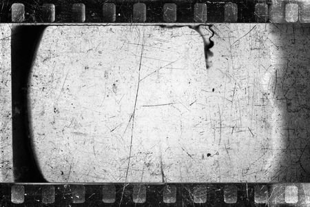 Old scratched and damaged grungy negative filmstrip Stock Photo