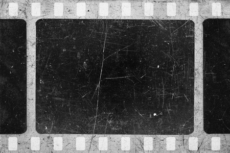 Old scratched and damaged grungy negative film