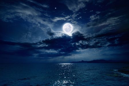 moon stars: Night sky with full moon and reflection in sea, stars, beautiful clouds.  Stock Photo