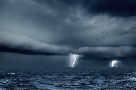 Nature force background - bright lightnings, dark stormy sky and sea, ocean
