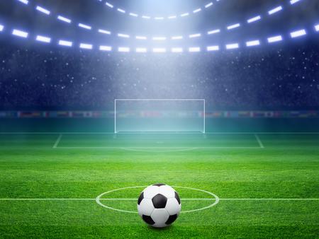 サッカーの背景、サッカー ボール、サッカー スタジアム、アリーナ照らされた夜の明るいスポット ライト、サッカー ゴール、緑の野原で