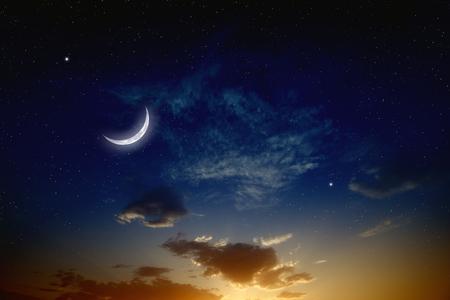 twilight: Beautiful romantic sunset, moon and bright stars in dark blue sky.  Stock Photo