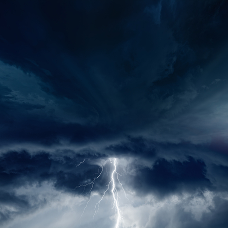 Dramatic nature background - bright lightning in dark stormy sky  photo