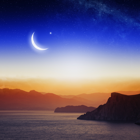Eid Mubarak background with moon and stars, holy month, Ramadan Kareem,  beautiful red sunset, mountain silhouettes.