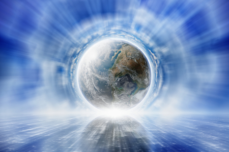 Abstract peaceful background - planet Earth in blue sky, light shines from the planet.