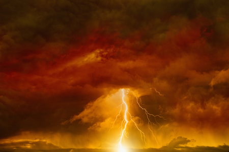 Apocalyptic dramatic background - lightnings in dark red sky, judgment day, armageddon Foto de archivo