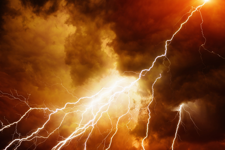 Apocalyptic dramatic background - bright lighnings in dark red stormy sky, judgment day, armageddon Standard-Bild