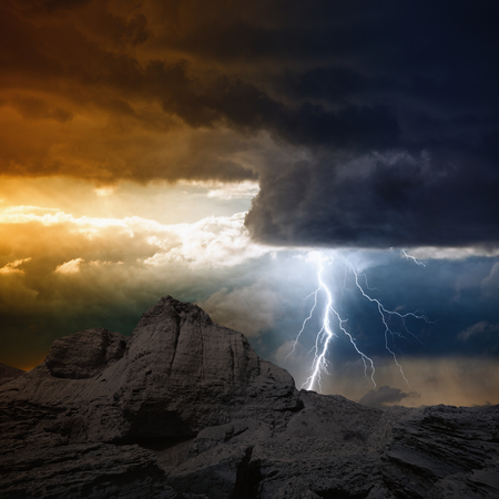 Nature force background - bright lightning from dark clouds hits mountain  Stock Photo