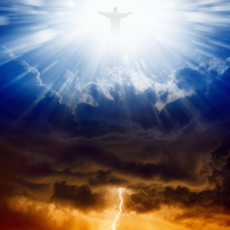 Jesus Christ in blue sky with clouds, bright light from heaven, heaven and hell