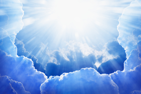 Peaceful background - beautiful blue sky with bright sun, light from heaven Stock Photo