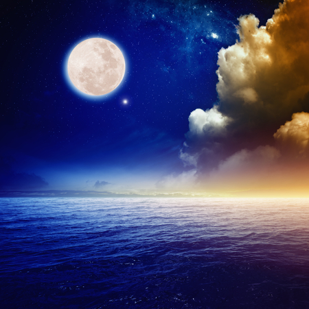 Peaceful background, sunset sky with full moon above sea, glowing clouds and horizon.
